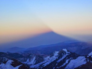 The shadow cast over the Andes Range by Aconcagua's summit from the rising sun. This is a treat they had today.