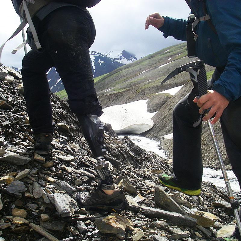 combat wounded veteran climbing mountain