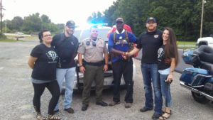 Gunny Brady's Walk Across America supporters in front of police car