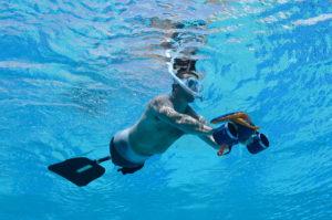 underwater amputee using lower torso fin