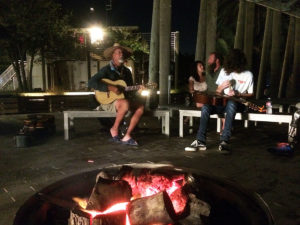 playing guitar by outdoor fire